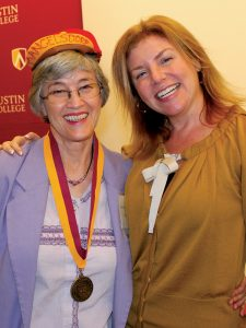 Elaine Mangelsdorf Hull sported her freshman beanie as President Marjorie Hass presented her with her Golden 'Roo medallion.