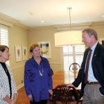 President O'Day stops in the dining room to get some inside details about the house from early residents Rebecca Moseley Gafford and Sara Caroline Moseley.